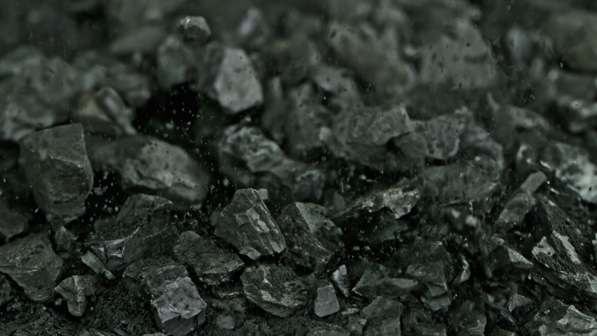 Super Slow Motion Shot of Falling Coal and Black Powder at 1000 fps.