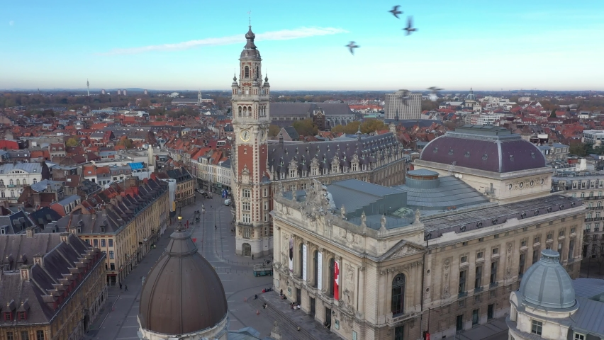 France, North, Lille, drone aerial view starting from opera and ending on the belfry of the chamber of commerce Royalty-Free Stock Footage #1062122725