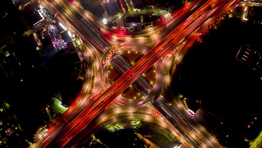 Night time-lapse of a city traffic aerial top view.