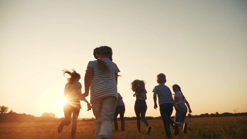 Happy family children kid together run in the park at sunset silhouette. people in the park concept. happy family joyful run. happy family and fun little baby child summer kid dream concept | Shutterstock HD Video #1062134308
