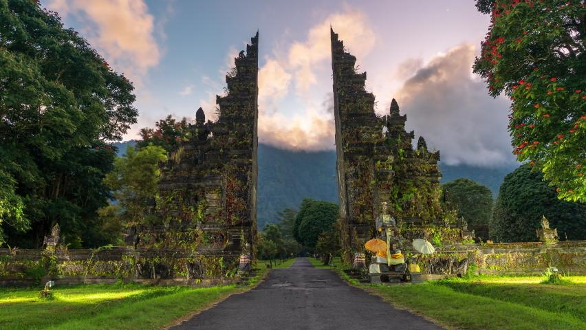 Gardian statue at entrance Bali temple / Bali Hindu temple / Bali, Indonesia Royalty-Free Stock Footage #1062148399