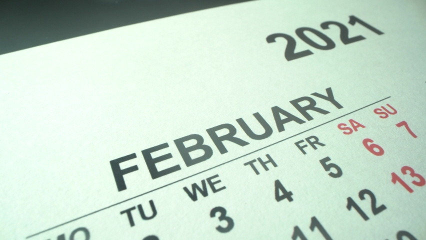 New calendar 2021 year. February and March in macro with dates and weekends marked. Macro | Shutterstock HD Video #1062156547