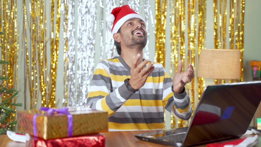 young man with holiday decorated background online gift order and rapid fast order delivery concept during christmas or new year holiday season sale at home. Royalty-Free Stock Footage #1062157396