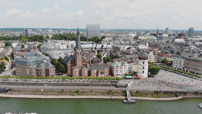 Establisher of Rhine embankment promenade, Dusseldorf, Germany. Aerial shot Royalty-Free Stock Footage #1062163003