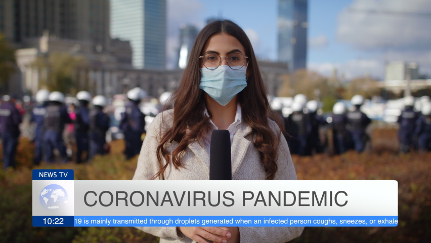 Caucasian Young Woman Journalist In Protective Mask Presenting Breaking News TV About Coronavirus Pandemic On Street Outdoors Lot Of People Police In Background Pandemic City Protest And March Slow Mo Royalty-Free Stock Footage #1062168226