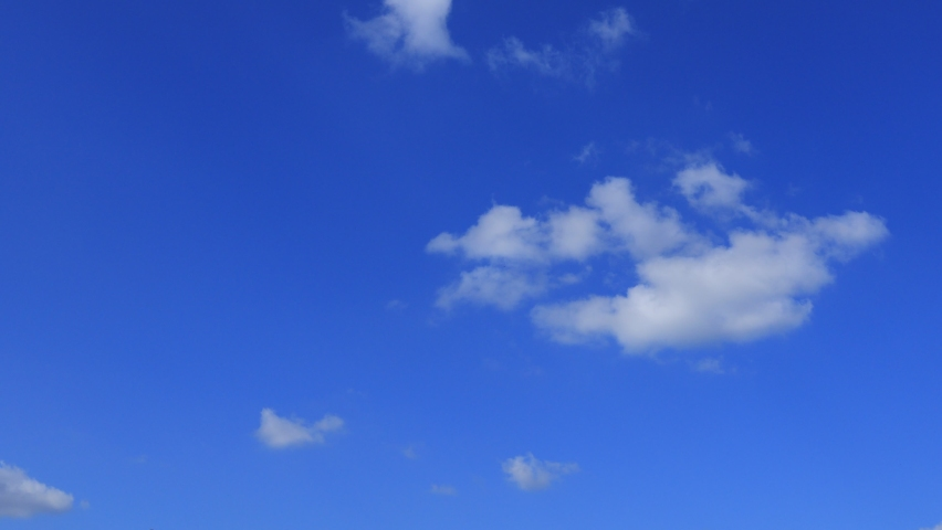 4k Blue sky white clouds. Puffy fluffy white clouds.Cumulus cloud cloudscape timelapse. Summer blue sky time lapse. Nature weather blue sky. White clouds background. Cloud time lapse nature background Royalty-Free Stock Footage #1062176575