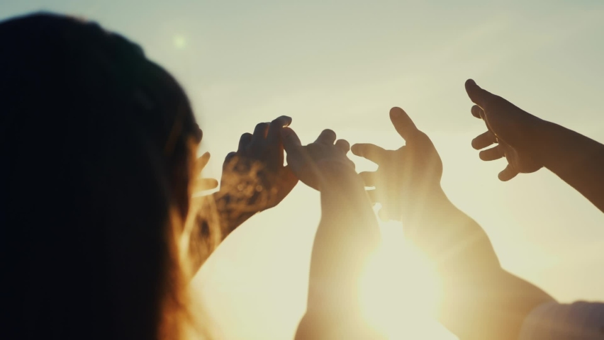 happy family people group pull hands to the sun teamwork. silhouette people party dancing recreation holiday. people at a music concert pull their hands up. religion concept sunlight lifestyle Royalty-Free Stock Footage #1062177724