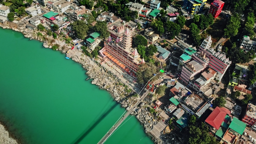 Aerial/Drone view of Rishikesh city, India, 4k, Lakshman Jhula bridge and Tera Manzil Temple, Trimbakeshwar in Rishikesh, a holy town, and travel destination in India. Hindus capital, 4k