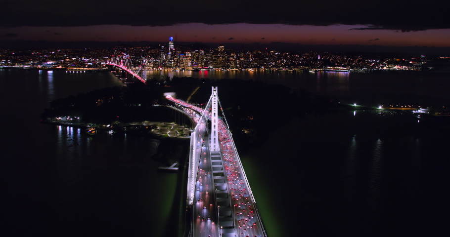 Amazing aerial view of the San Francisco Oakland Bay Bridge during rush hour, full of traffic. Night time. Interstate 80. California, USA. Shot on Red weapon 8K.