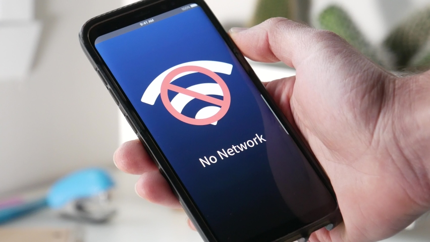 Holding a mobile phone not receiving any wifi signal. the screen is showing the wifi icon not functioning. Royalty-Free Stock Footage #1062204289