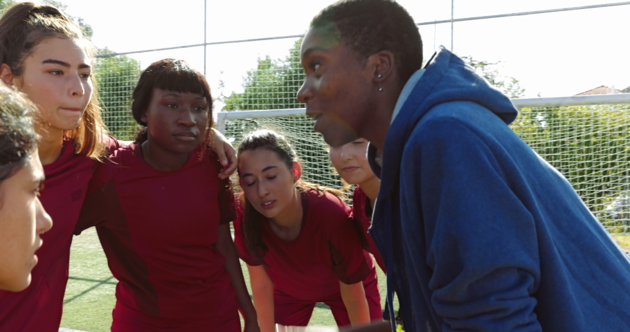 Female soccer players listening to their coach before game Royalty-Free Stock Footage #1062206377