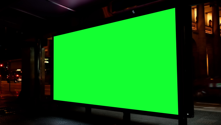 Night city street billboard stand with green screen. Green screen for text or copy. | Shutterstock HD Video #1062220990