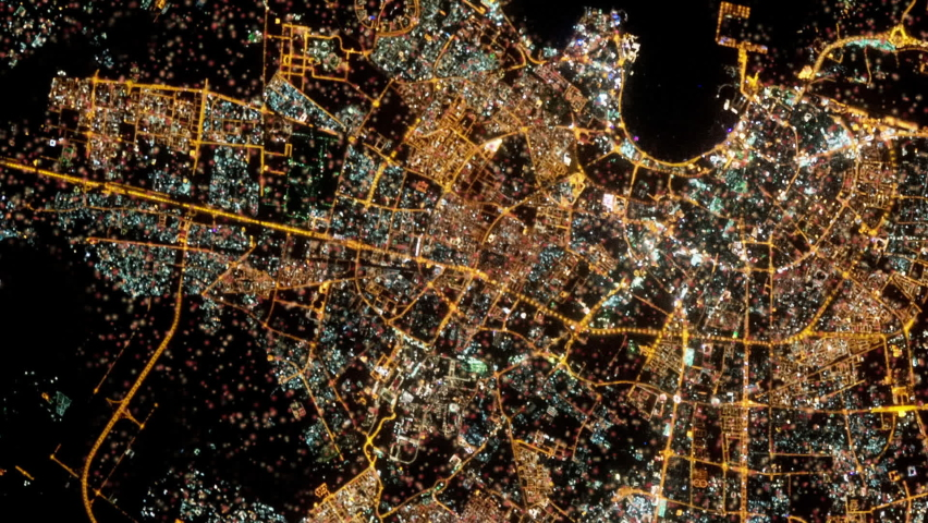 City of Dubai Arab Emirates satellite aerial view by night with moving and flashing lights. Images furnished by Nasa