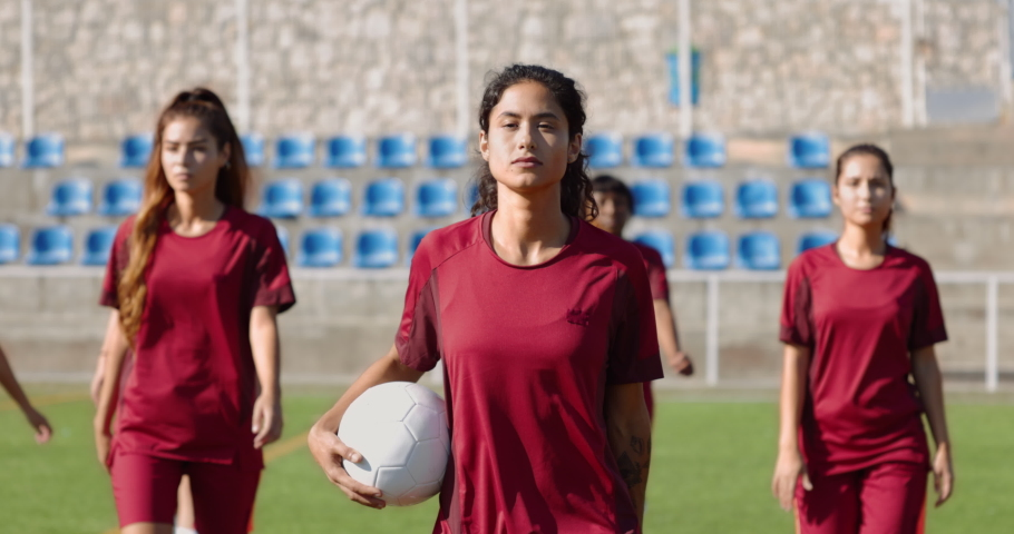 Group of confident female soccer players walking before game Royalty-Free Stock Footage #1062223774