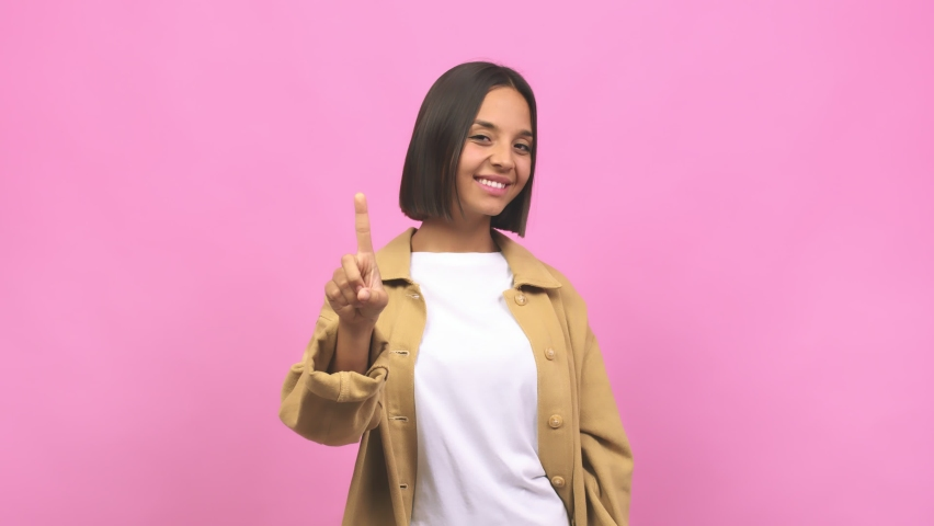 Young indian woman showing number one, symbol of counting, concept of mathematics, confident and cheerful | Shutterstock HD Video #1062232828