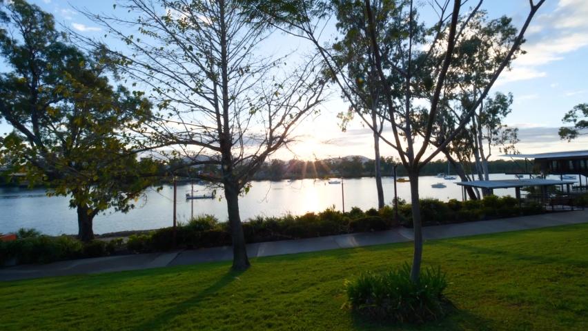 Quiet Riverside Park, Rockhampton - Sunrise Royalty-Free Stock Footage #1062276016
