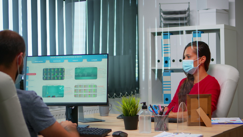 Woman with protection mask having online meeting conference in modern new normal office. Freelancer working in workplace chatting with remotely team during virtual webinar using internet technology Royalty-Free Stock Footage #1062290134