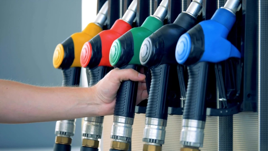 Gas station Gas pump close up. pump nozzles at gas station Royalty-Free Stock Footage #1062299503