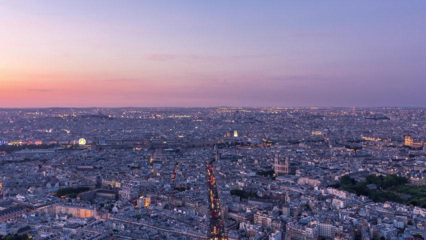 Panorama of Paris after sunset day to night transition timelapse. Top view from observation deck of montparnasse building in Paris - France. Colorful sky at summer day | Shutterstock HD Video #1062309109