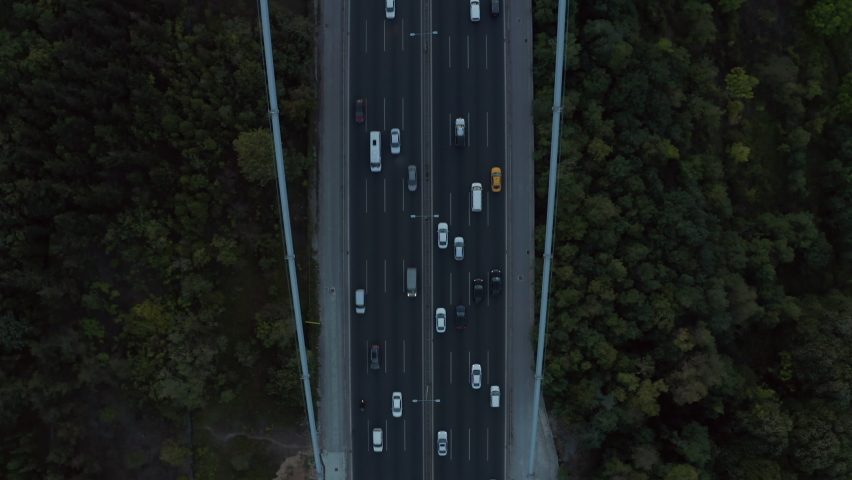 Cars driving onto Bridge towards City Skyline in Istanbul, Turkey over Bosphorus, Aerial birds eye view tilt up | Shutterstock HD Video #1062324634
