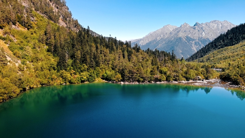 Lakes in mountains, national park of Dombay, Caucasus, Russia. Autumn landscape, sunshine weather, blue sky and sunny day. Aerial high quality 4k footage | Shutterstock HD Video #1062338641