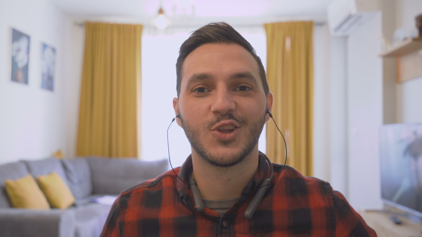 POV shot of young man working from home with earphones and webcam Royalty-Free Stock Footage #1062338986