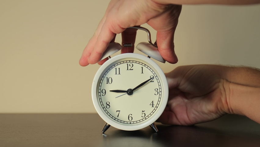 Setting clock back by one hour for ending summer daylight saving time in the autumn in October Royalty-Free Stock Footage #1062357700