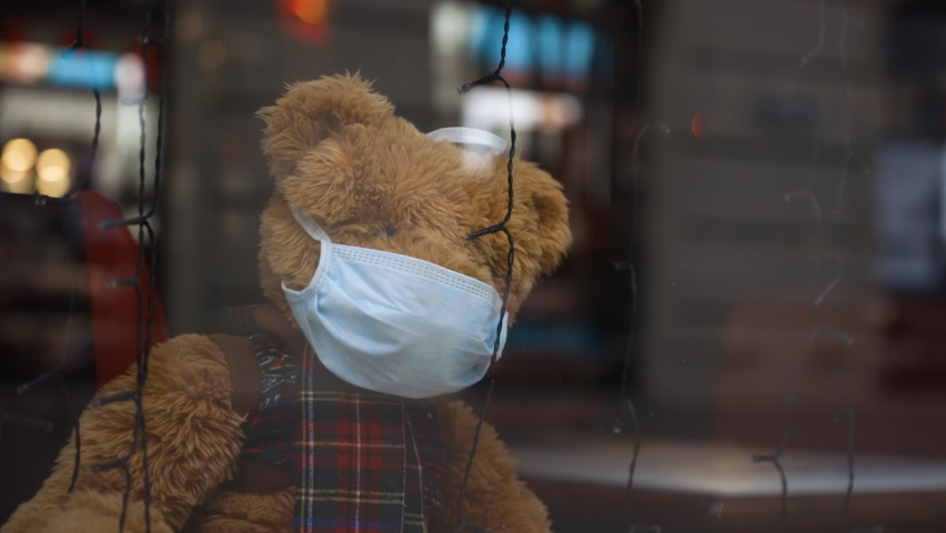 Lonely christmas teddy bear wears medical face mask Royalty-Free Stock Footage #1062357994
