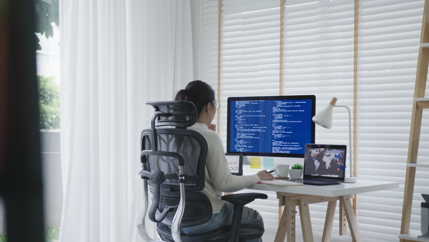 Back rear view of young asian woman, freelance data scientist work remotely at home coding programing on Big data mining, AI data engineering, IT Technician Works on Artificial Intelligence Project. Royalty-Free Stock Footage #1062364000