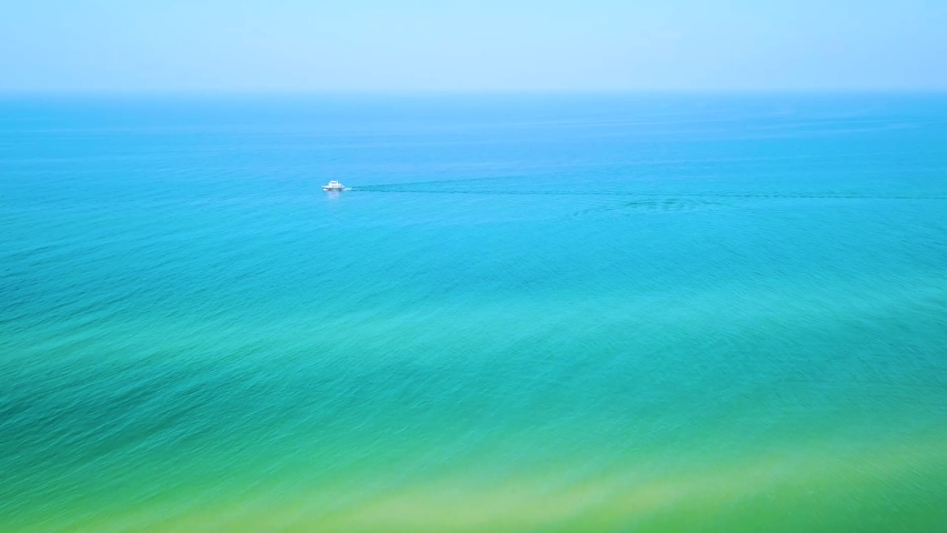 Boat on Tropical Turquoise Waters. Aerial Drone view & Copy Space for Text