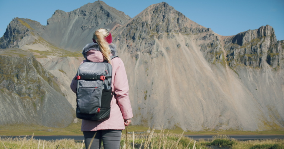 Rear view of women discover Stokksnes looking at Vestrahorn mountain in the background. Nature and travel concept | Shutterstock HD Video #1062379681