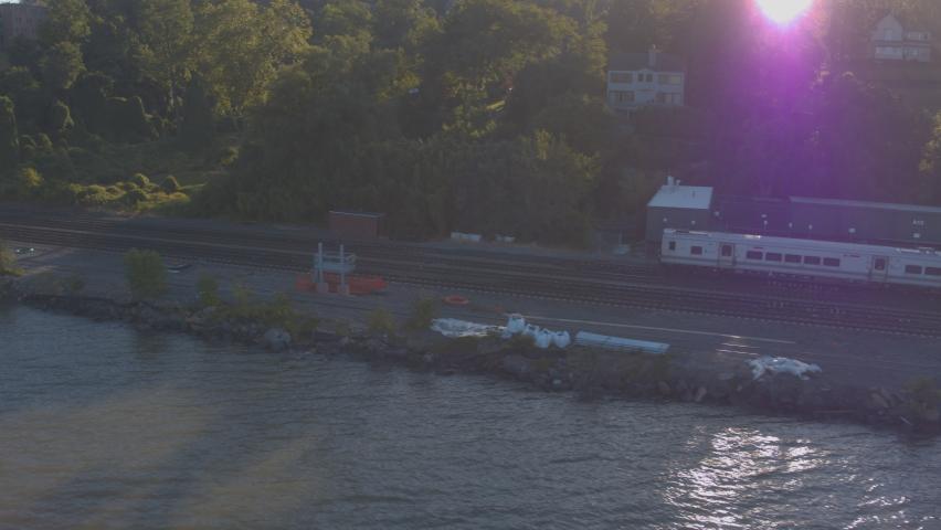 Aerial Drone Shot Tracking Train Leaving New York City Along Hudson River | Shutterstock HD Video #1062398722