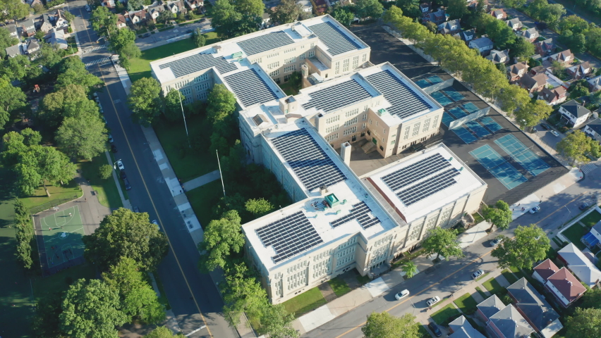 Aerial Drone Shot Flying Toward a Large PV Solar Installation on Bayside HS Roof | Shutterstock HD Video #1062398815
