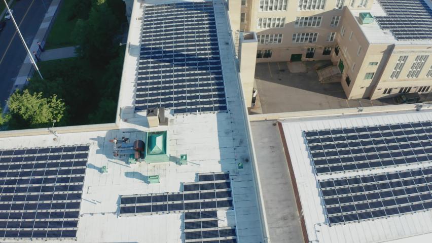 Aerial Drone Shot Orbiting a Large PV Solar Installation on Bayside High School | Shutterstock HD Video #1062398821