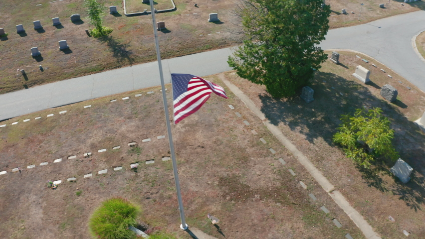 Aerial Drone Shot Orbiting a US Flag in Mt Feake Cemetery in Waltham Mass