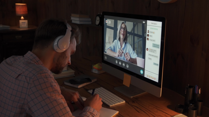 Male student wears headphones conference video calling, watching webinar stream, taking online training class virtual chat meeting with remote teacher, tutor or coach distance learning using computer. Royalty-Free Stock Footage #1062406849