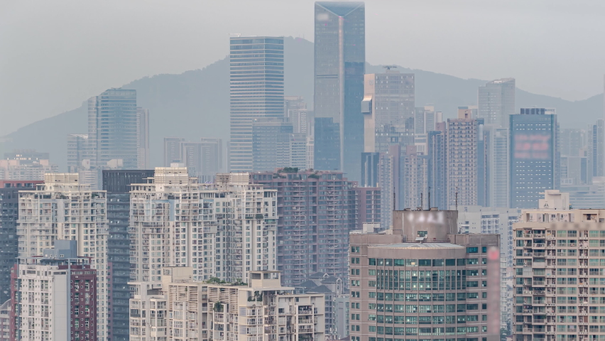DAY TO NIGHT TIMELAPSE OF DOWNTOWN APARTMENT BUILDINGS PAN DOWN CHINESE CROWDED CITY OVERNIGHT FAST PACED MODERN ASIAN NIGHT SCAPE TIME LAPSE IN URBAN METROPOLIS OF SHENZHEN.   Shutterstock HD Video #1062427087