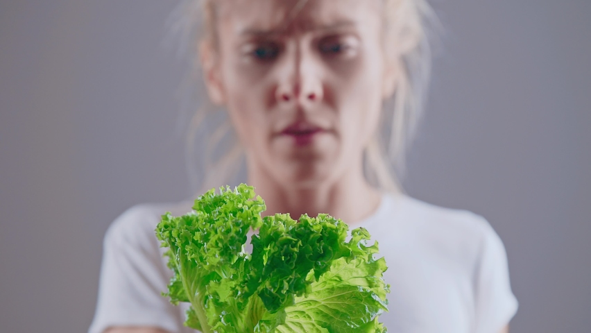Anorexic young woman bored with diet. Dieting eating disorders and weight loss concept
