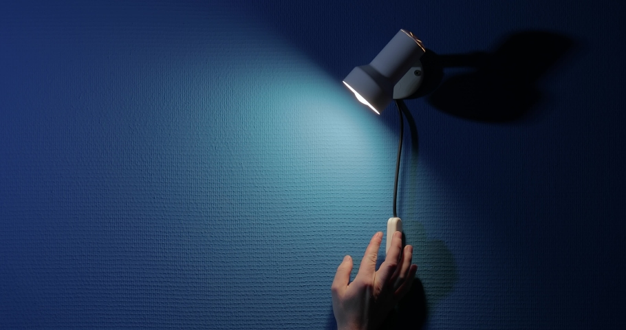 Turning on night light lamp above the bed, dim moonlight from the window | Shutterstock HD Video #1062455557