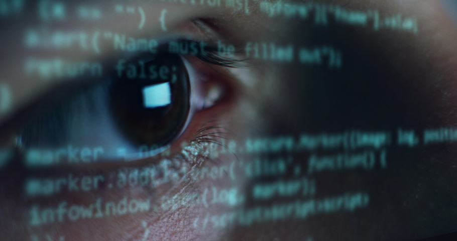 Cinematic macro of young programer's eye while busy working with latest innovative sophisticated technology display application with augmented reality holograms for realization of new codeproject. Royalty-Free Stock Footage #1062499588