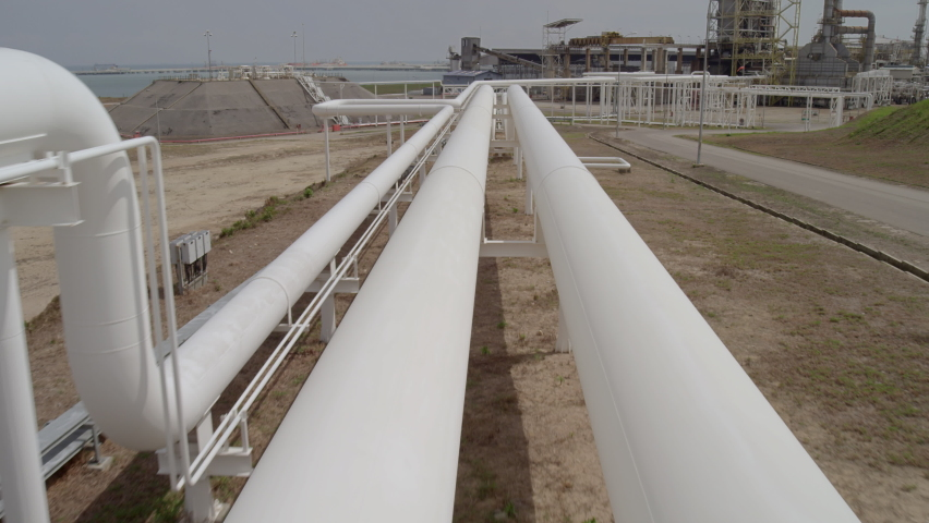 Monitoring and maintenance of liquid natural gas pipelines using drone surveillance as modern efficient way of checking crucial conduits and pipes for industrial petrochemical supply infrastructure. Royalty-Free Stock Footage #1062517579