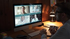 Business man meeting virtual team on video conference call using computer. Social distance worker working from home office talking to diverse colleagues in remote videoconference online zoom chat.