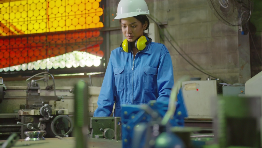 portrait asian female Professional engineering wearing uniform and safety goggles Quality control, maintenance, measurement metal  checking process in factory, warehouse Workshop for factory operators Royalty-Free Stock Footage #1062529528