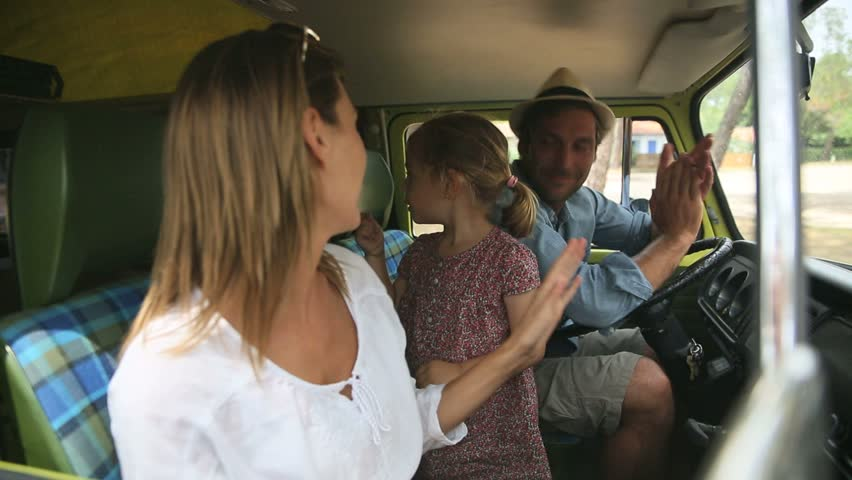 Family having fun singing in camper van | Shutterstock HD Video #10625318