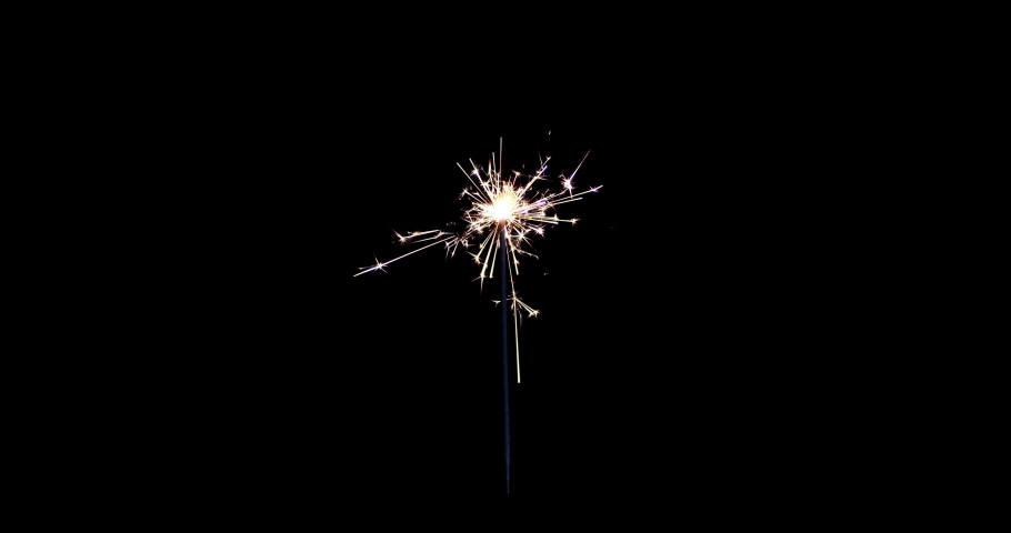 Lightening Christmas sparkler on the black background. Christmas sparkler concept. Bengal lights are burning on a black background. Holiday party concept. Christmas and newyear party sparkler. Royalty-Free Stock Footage #1062559378