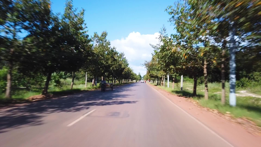 Driving motor on the sunny day on the road of Cambodia. First person view hyper- lapse with beautiful greenery.  POV. Point of view  | Shutterstock HD Video #1062559468