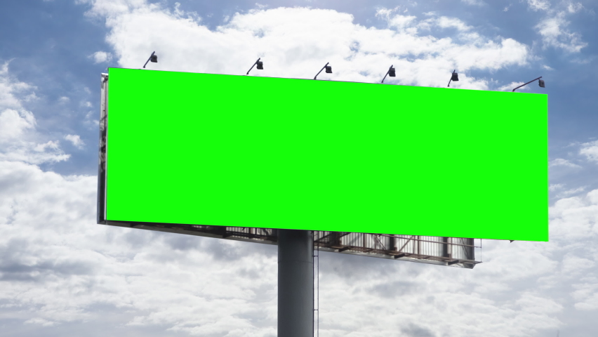 Empty large billboard with a green screen for advertising against sky with clouds timelapse