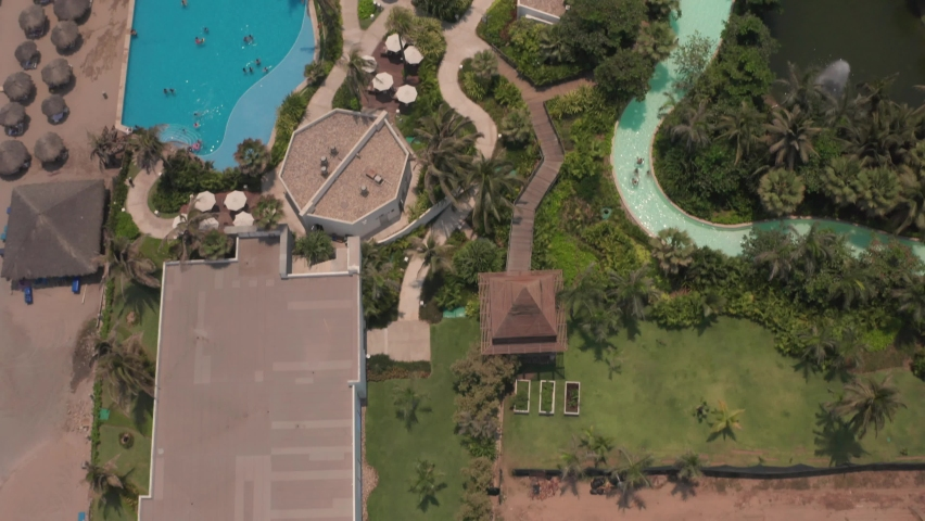 Birds Eye Aerial View of Pools and Beachfront of Upscale Apartment Building in Acapulco, Mexico