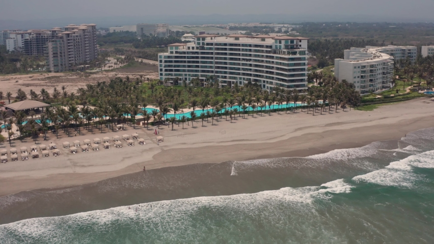Acapulco Beach and Waterfont Mexico. Aerial View on Ocean Waves and Luxury Condomium Building With Pools