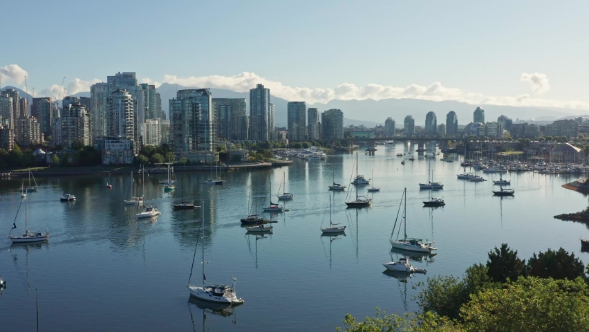 Stunning Drone Aerial Shot Over the Vancouver Marina, Moving Closer to the Cityscape Skyscrapers Canada.